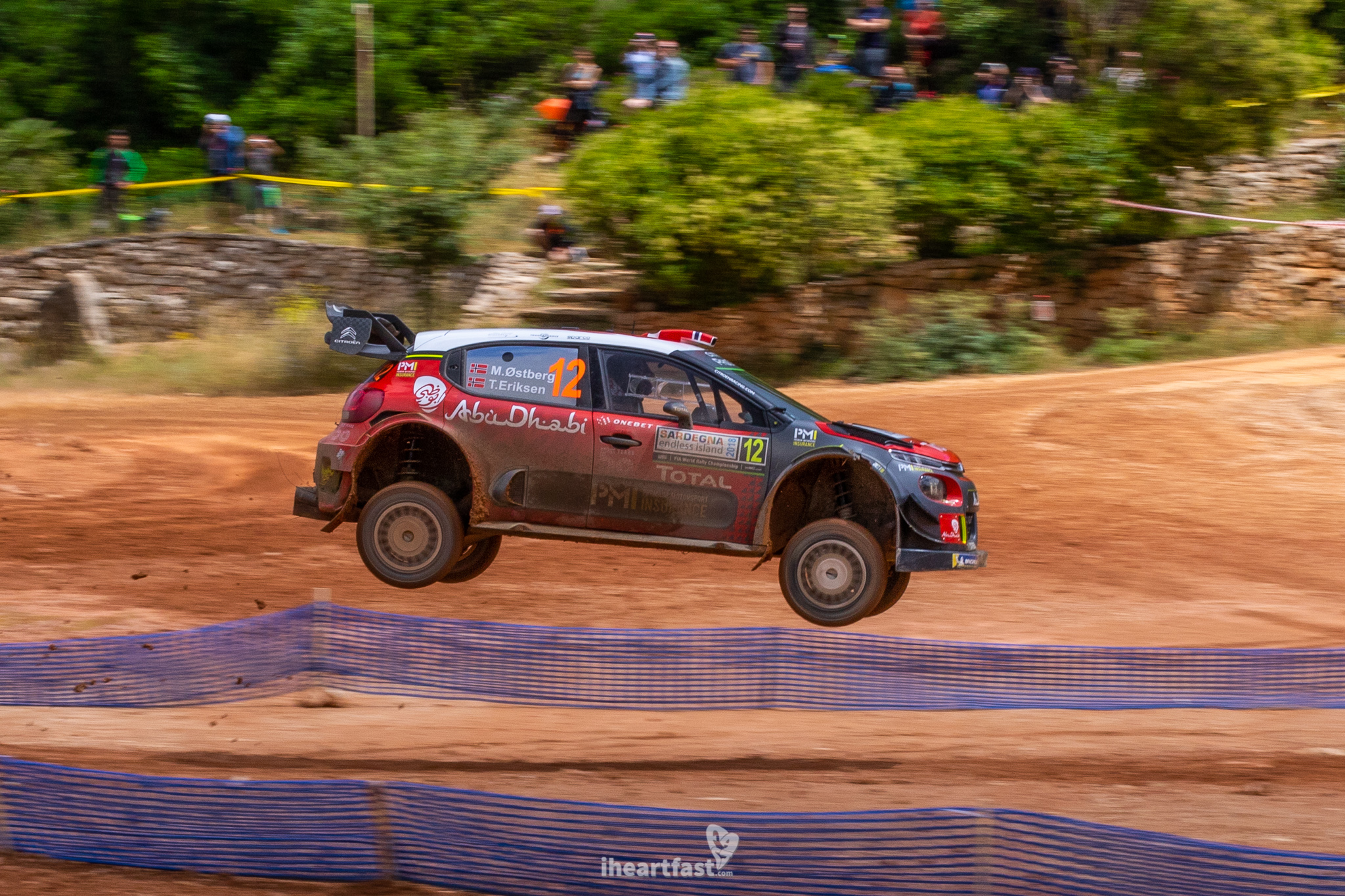 Mads Ostberg jumps his Citroen at WRC Rally Italia Sardegna