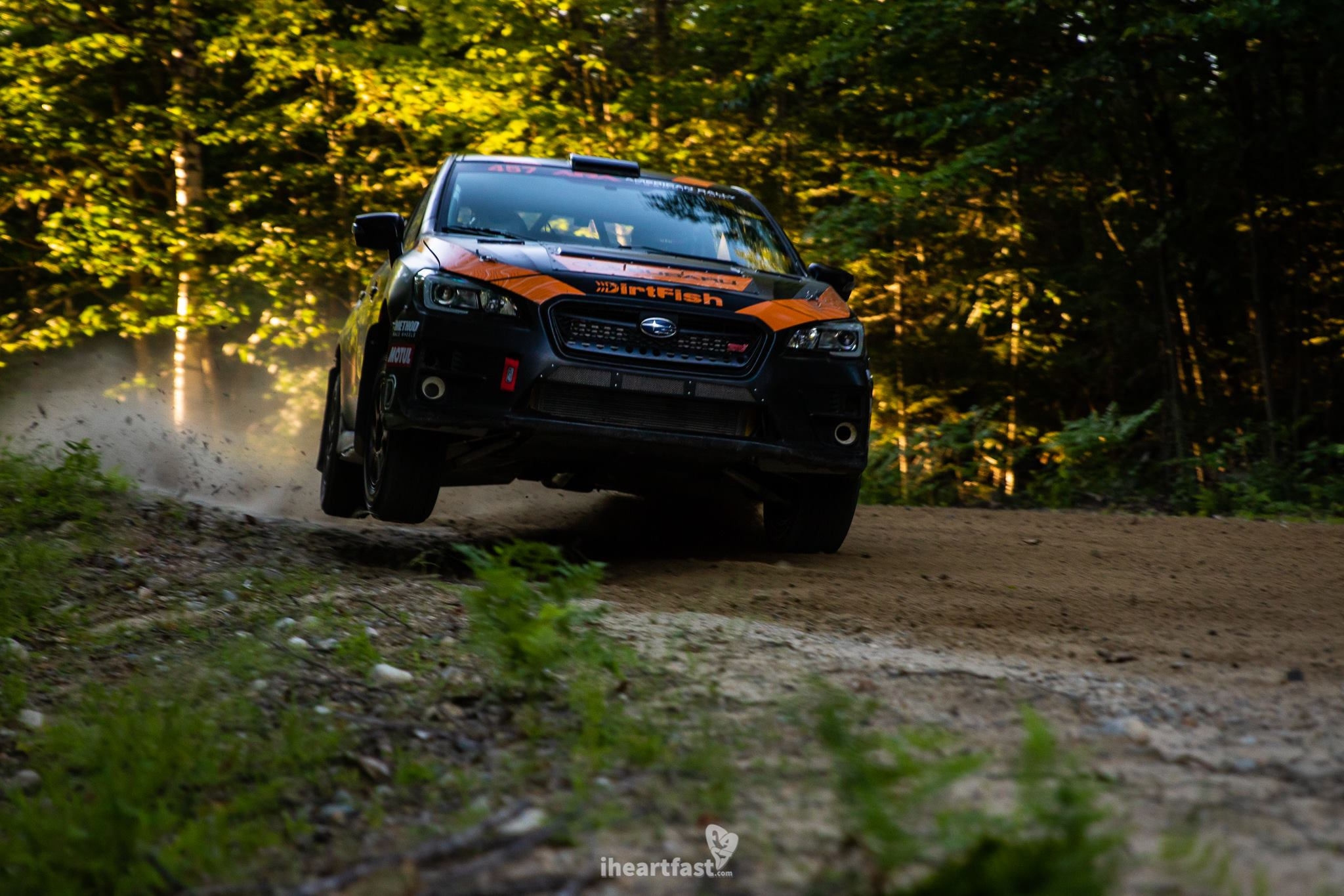 Sam Albert and Michelle Miller launch their DirtFish Subaru off a rock at NEFR
