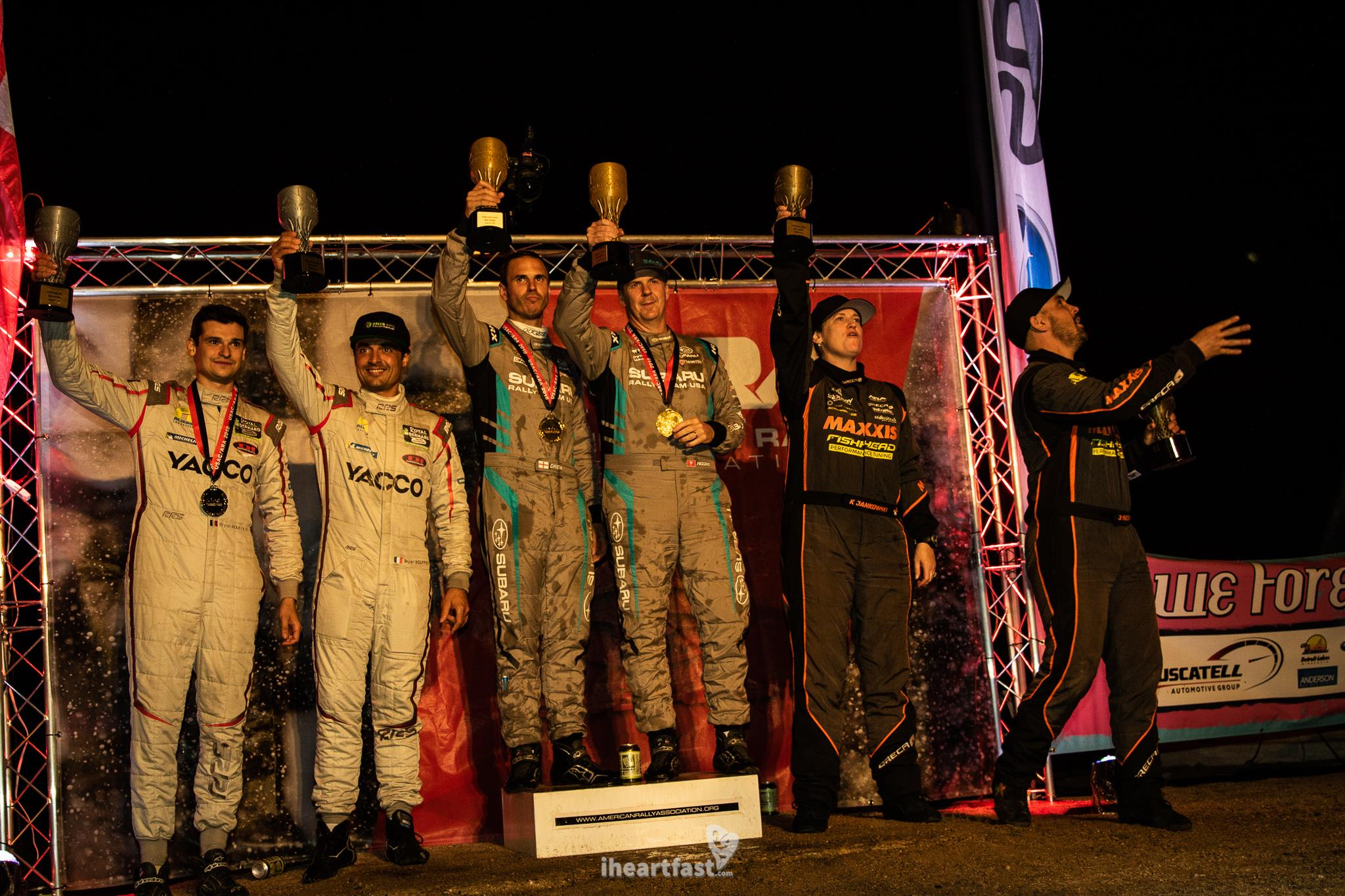 Higgins and Drew stand atop the podium at Ojibwe Forests Rally