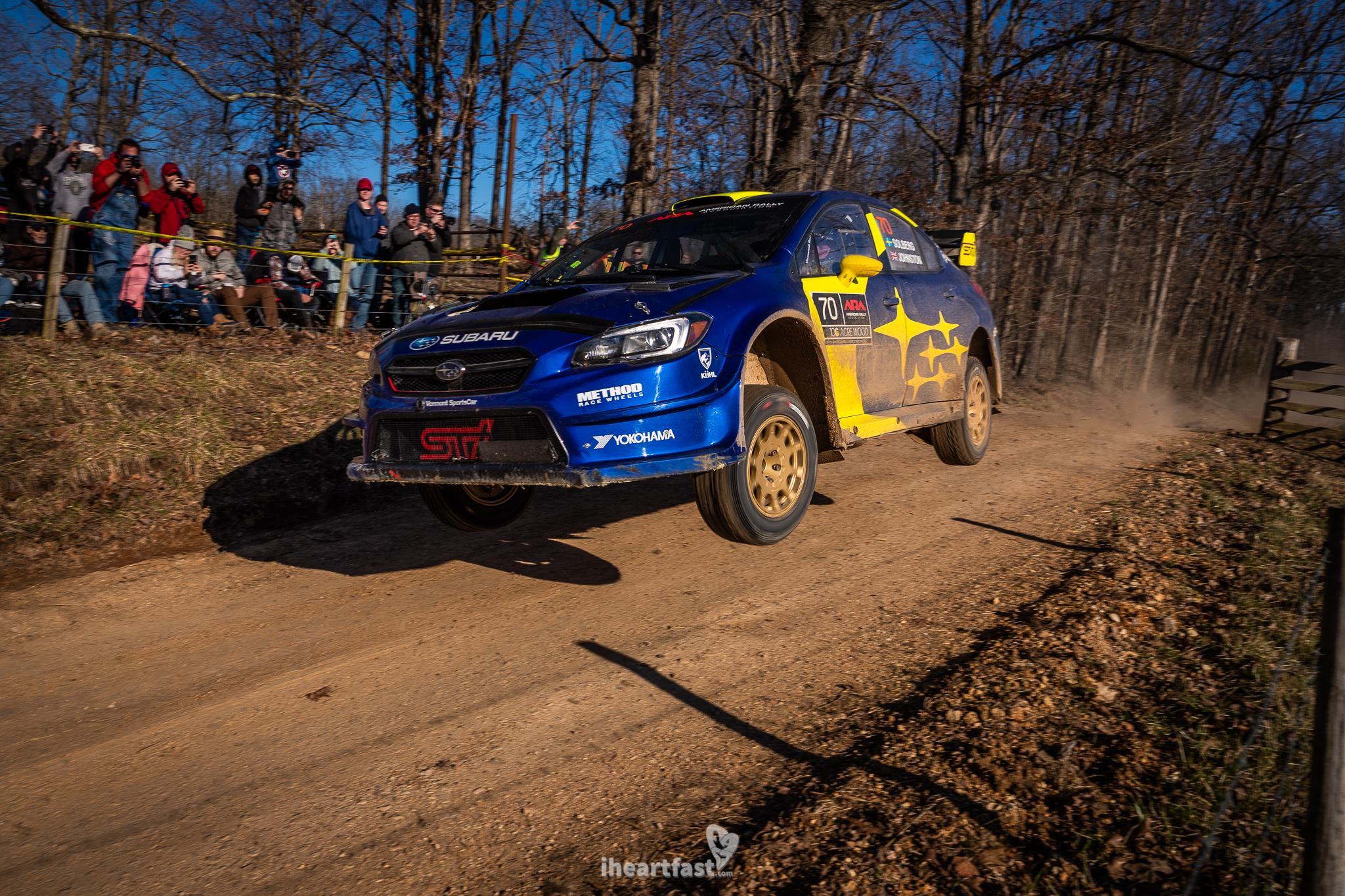 Oliver Solberg flying over the famous cattle guard jump in his Subaru Motorsports STI at 100 Acre Wood