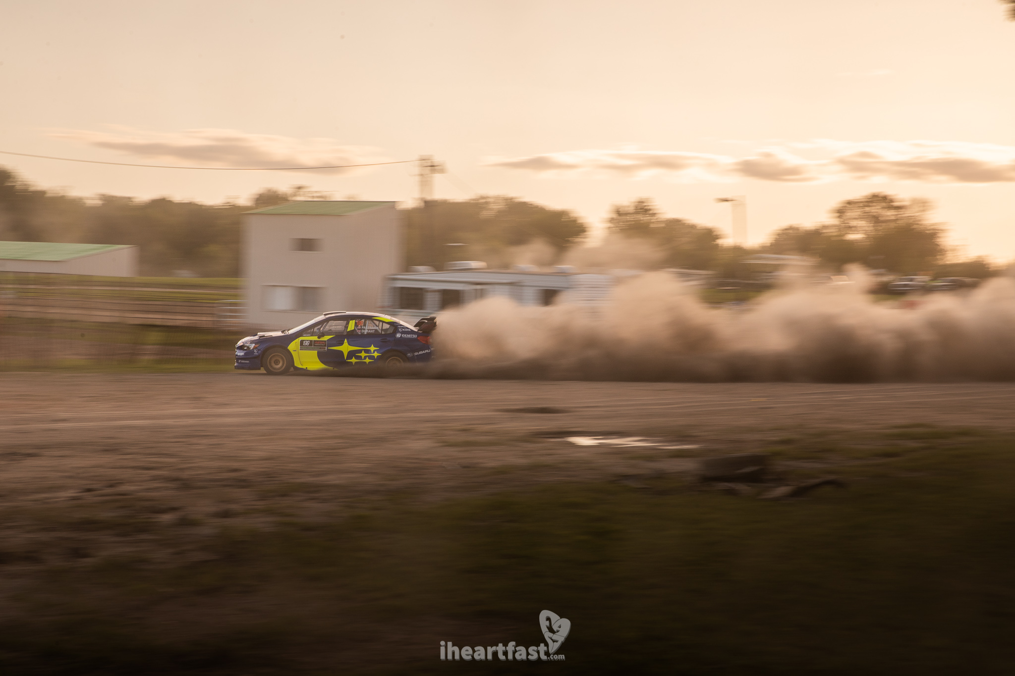 Travis Pastrana slides his Subaru Motorsports USA car around the Fairgrounds at Ojibwe Forests Rally